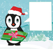 Cute penguin with gift box Stock Photos