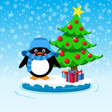 Cute penguin with gift boxes and Christmas tree Royalty Free Stock Photos