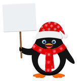 Cute penguin in red hat with blank banner isolated on white background Royalty Free Stock Images