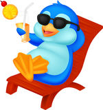 Cute penguin sitting on beach chair Royalty Free Stock Images
