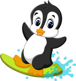 Cute penguin surfing cartoon Royalty Free Stock Images