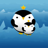 Cute penguins with crowns Royalty Free Stock Photo