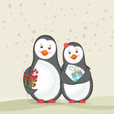 Cute penguins for Happy Valentines Day celebration. Cute couple of penguins holding gift and red roses on hearts decorated background for Happy Valentines Day Stock Image