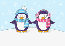 Cute penguins on snow background Stock Photos