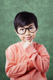 Cute pensive child in the classroom Stock Photo