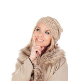 Cute Pensive Girl with coats winter clothes Stock Photo