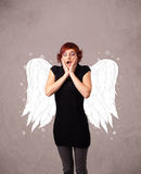 Cute person with angel illustrated wings Royalty Free Stock Photography