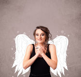 Cute person with angel illustrated wings Stock Photo