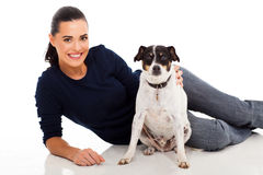 Pet dog owner. Cute pet dog with its female owner relaxed Royalty Free Stock Photo