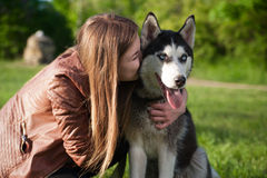 The cute photo of a girl huging her dog Royalty Free Stock Image