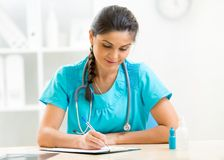 Cute physician woman working in her office Stock Image