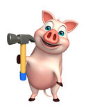 cute Pig cartoon character with hammer Stock Photography