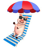 Cute Pig cartoon character with sunglass and beach chair Royalty Free Stock Image