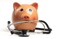 Piggy and Stethoscope Royalty Free Stock Images