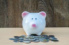 Cute piggy bank on a stack of cash. Royalty Free Stock Images