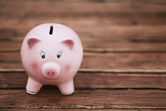 Cute Piggy Bank on the Wooden Table Royalty Free Stock Photo