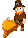 Cute pilgrim with wheelbarrow Royalty Free Stock Photography