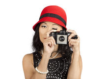 Cute pin up Asian lady taking photo with camera Royalty Free Stock Photography