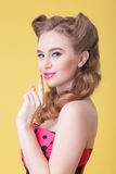 Cute pin-up girl is asking for silence Stock Photos