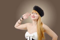 Cute pin up girl giving a salute. Royalty Free Stock Photos