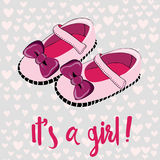 Cute pink baby shoes for newborn girl. It`s a girl. Greeting card. Vector illustration on pink heart pattern background. Hand drawn pink baby shoes for newborn vector illustration