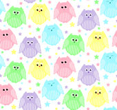 Cute pink, blue, violet, green and yellow owls with stars in the Royalty Free Stock Photo