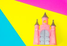 Cute pink Castle toy on blue, yellow and pink background vector illustration