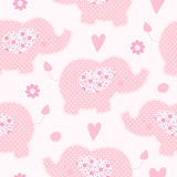 Cute pink elephant seamless vector background. Hearts and flowers around. Patchwork style Stock Image