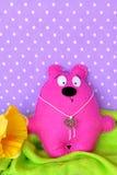 Cute pink felt Teddy bear. Hand made children toy, sewing craft Stock Photo