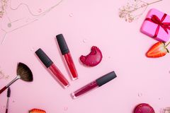 Cute pink flat layand lipstick with lip gloss in the center. Glamorous style royalty free stock images