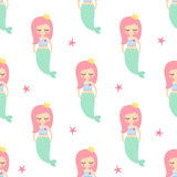 Cute pink hair mermaid girl with starfish seamless pattern on white background. Stock Photo