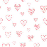 Cute pink hearts  on white background. Seamless pattern. Royalty Free Stock Photo