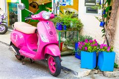 Cute pink motorbike in streets of Kos island, Greece royalty free stock photos