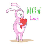 Cute pink rabbit with a big red heart in his paws. Hand-written inscription My great love. Stock Photo