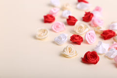 Cute pink, red, white and cream flowers on a cream background Stock Image