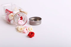 Cute pink, red, white and cream flowers in a glass jar on a White background Royalty Free Stock Photos