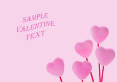 Cute Pink Valentine Hearts on Pink Background. Horizontal closeup of pink, fuzzy 3D hearts on a pink background with empty area for copy, text Stock Photo
