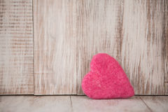 Cute Pink Valentines Day Heart on Vintage Wooden Background Stock Photos