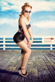 Cute Pinup Girl Looking Surprised On Beach Pier Royalty Free Stock Images
