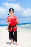 Cute pirate on beach Stock Images