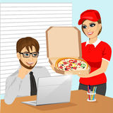 Cute pizza delivery girl brings the pizza a young businessman in office Stock Images