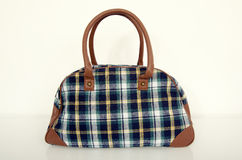 Cute plaid bag. Green with brown tartan bag on white. Royalty Free Stock Images