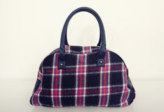 Cute plaid bag. Pink with blue tartan bag on white. Cute plaid bag. Pink with blue tartan bag on white on white shelf Stock Image