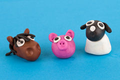 Cute plasticine farm animals collection - Pig, horse, sheep. Cute plasticine farm animals collection isolated on blue background. Pig, horse, sheep stock photo