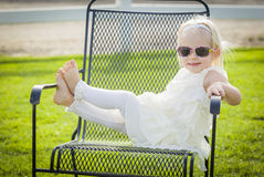 Cute Playful Baby Girl Wearing Sunglasses Outside at Park Stock Images