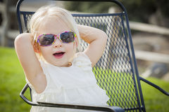 Cute Playful Baby Girl Wearing Sunglasses Outside at Park Royalty Free Stock Images