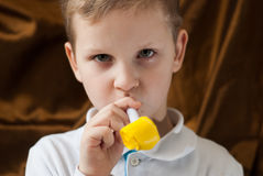 ,a cute playful child in a white shirt Stock Images