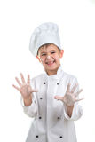 Cute playful little chef with flour on his hands.  Royalty Free Stock Image