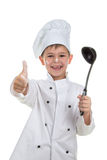 Cute playful little chef with soup ladle on white background.  Royalty Free Stock Photography