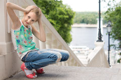 Cute playful little girl playing outdoors Royalty Free Stock Photography